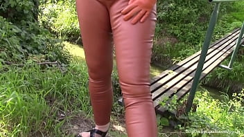 Smoking in cinnamon leather trousers