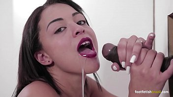 Naughty Polly Petrova swallowing a huge black dick and doing a beautiful footjob with a hard cumshot on her face
