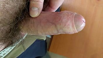 Playing with my hard uncut cock