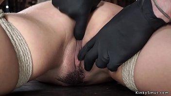 Brunette gets fingered in hogtie