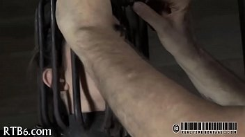 Restrained cutie is punished