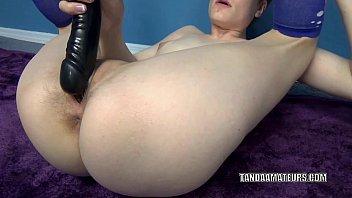 Horny hottie Ava Little masturbates with a big black dildo
