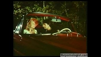 Blonde Anna Magle gets fucked doggystyle in a car in vintage porn movie thumbnail