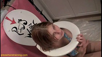 Teen piss whore Dahlia licks the toilet seat clean
