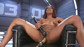 Ebony fucks machine and squirts on it