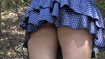 Short skirt sexy butts Under a skirt without panties. hairy pussy and big ass in a short dress climbs mountains in nature.