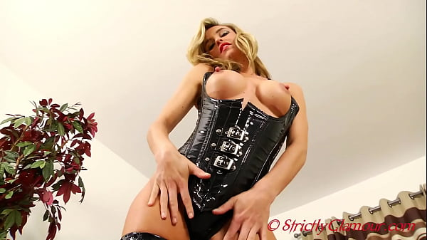 Magnificent Blonde Short Haired Mistress Melanie Dress In A Cupless Latex Rubber Corset and Knee High Boots Begins Her Teasing Trance To Extract The Cum From Your Body