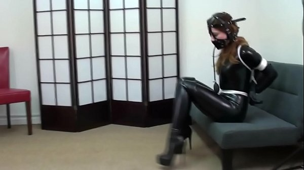 Pretty brunette tied f. latex gagged with boots...
