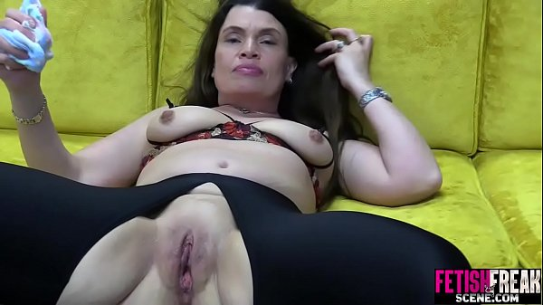 FetishFreakScene Pussy gapping with huge red dildo Thumb