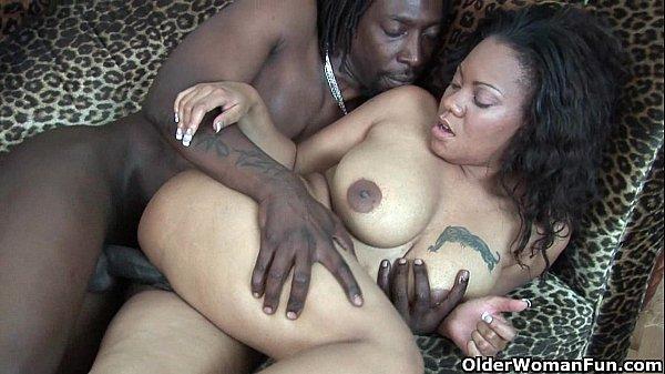 Ebony milf takes cumshot