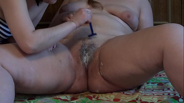 Lesbian shaves her girlfriend's fat pussy and l...