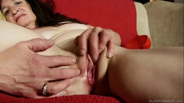 Sexy granny talks dirty and fucks her soaking wet pussy
