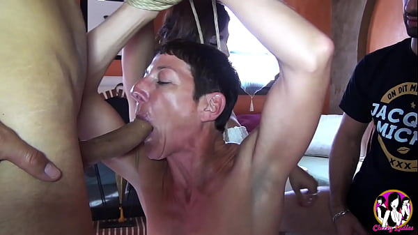 Short haired Milf enjoy all these cocks