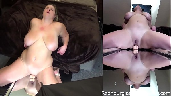 Big tit blonde girl Meloni douses her 36 DDD jugs in oil and fucks a mirror dildo