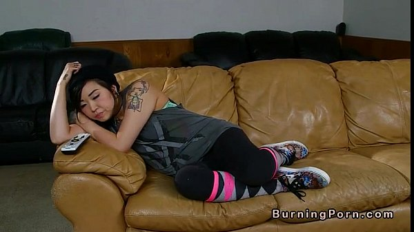Tattooed Asian nanny fucked on leather couch Thumb
