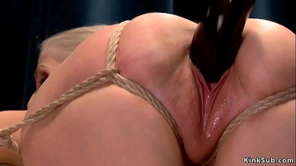 Busty blonde in tight bondage gets dildo