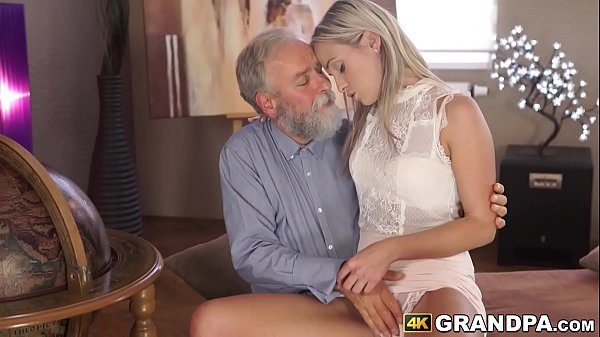 Gorgeous blonde chick cuddles with grandpa before sex