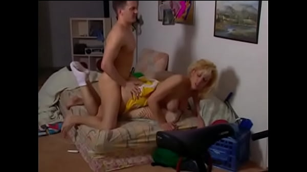 Slutty mommy in cheerleader costume Randi Storm gives a blowjob to a young guy and gets a mouthful of cum