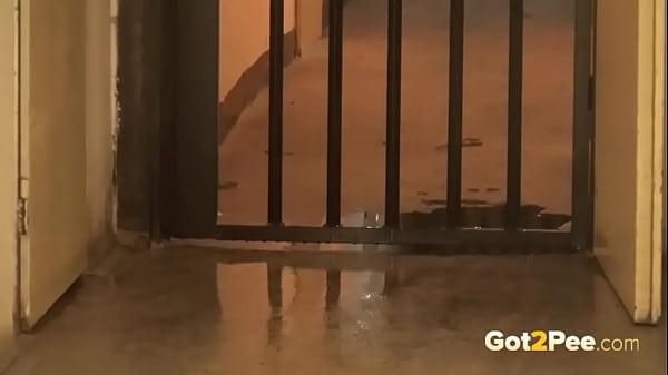 Pee Desperation - Hot brunette relieves herself outside in a doorway