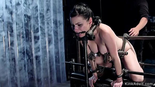 Brunette in doggy device gets whipped