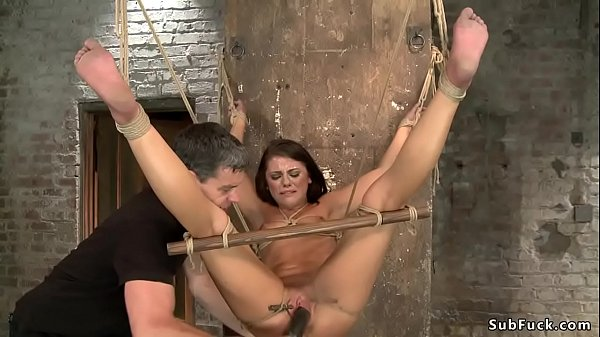 Bound brunette is toyed and gagged