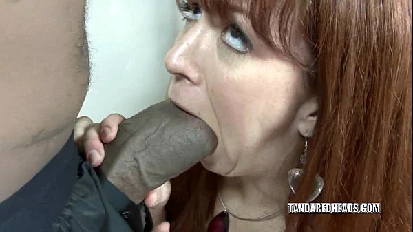 Redhead hottie Trinity Post takes on a huge black cock