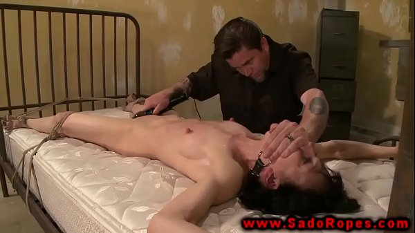 Gagged and tied sub in bdsm session with her master