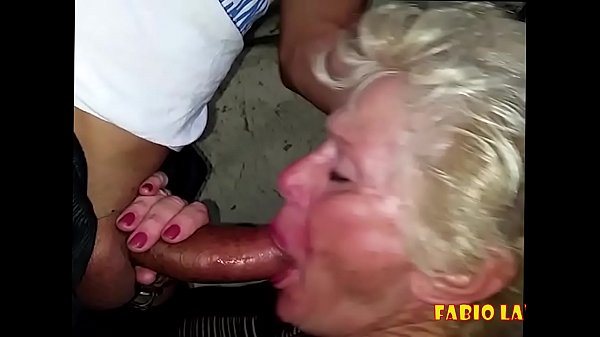 Old lady doing blowjob under the overpass