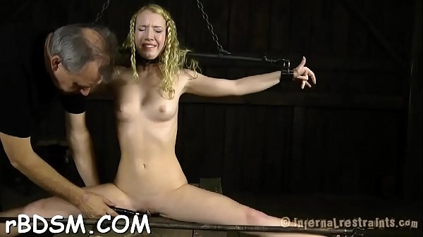 Angel gets her neck restrained and knockers clamped