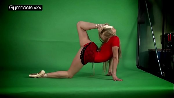 Red Dressed Gymnast Doing Spreads Thumb