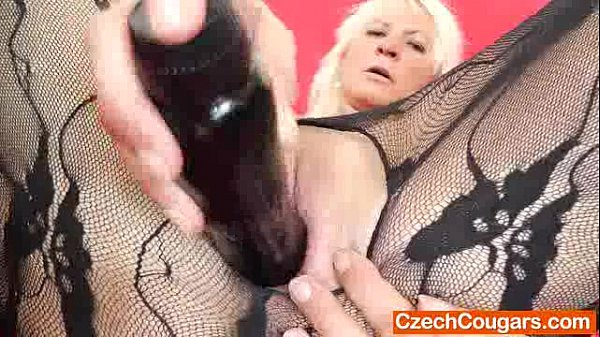 Blond-haired madame fucking herself with a fake cock Thumb