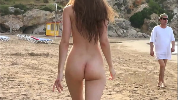 Naked sexy girl walking on the beach