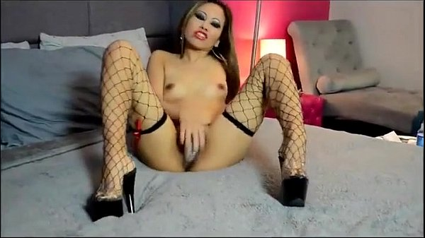 Hot Nasty Asian Beauty in Red Smokes and Masturbates CamGirlCumClub.Com