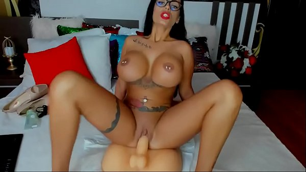 Inked up model fucks her stunt cock - HotJizzcams.com