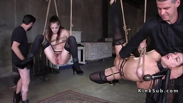 Two slaves fucked in rope suspension Thumb