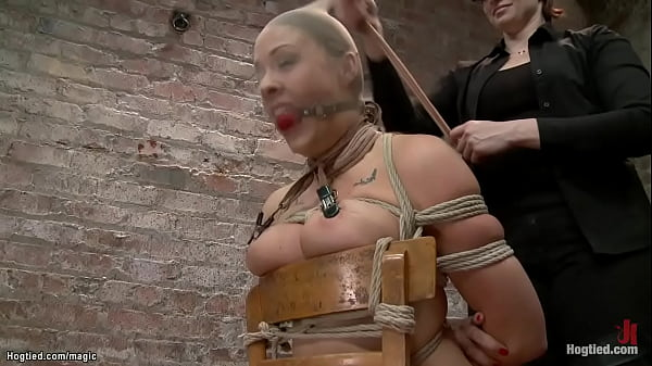 Busty lesbian bound to wooden chair