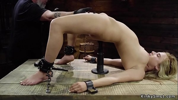 Busty blonde slave in bondage throne