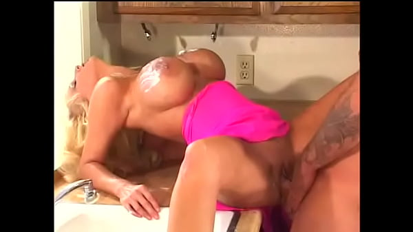 Dude was looking for ice cream in the fridge but he saw huge naked tits of playful blonde Tia Gunn and forgot about everything else