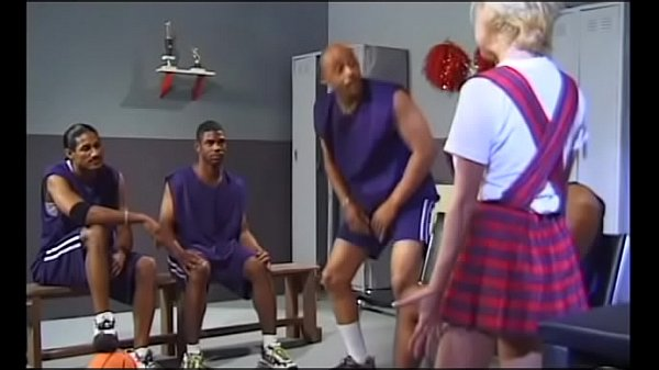 A young slut in a short dress serves the black guys' basketball team in the locker room after the game Thumb