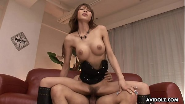 Busty Asian idol wears leather boots while ridi...