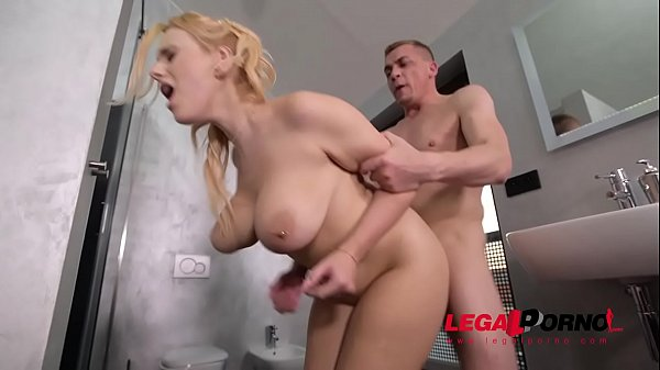 Top-heavy blonde pornstar Angel Wicky fucked in...
