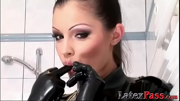 Dashing dyke teases showering in tight latex and high heels