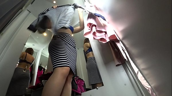 Peeping into the public dressing room, a view from below on a juicy ass and on a sexy girl with long legs, hidden camera. Thumb