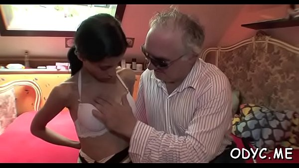 Horny young babe gives an old stud nice blowjob...