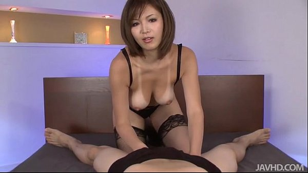 Sexy tanned Mai Kuroki in bed playing with a ho...