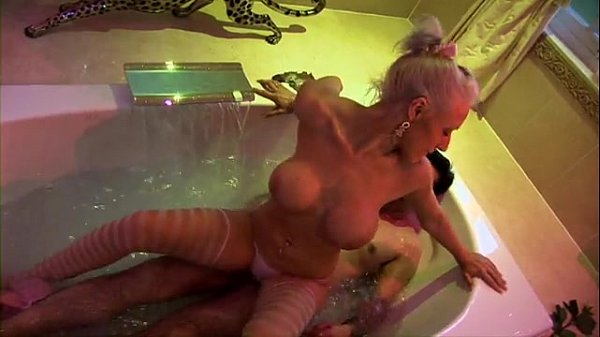 Two busty blondes give lucky guy a bath