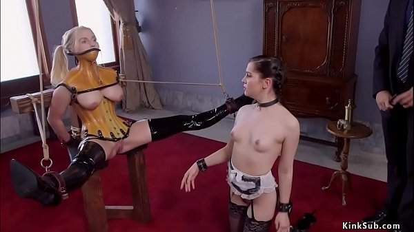 Slave in plastic corset anal fucked