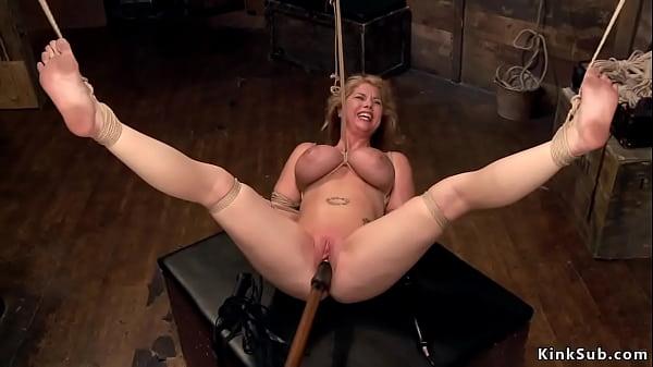 Busty blonde in hogtie suspension
