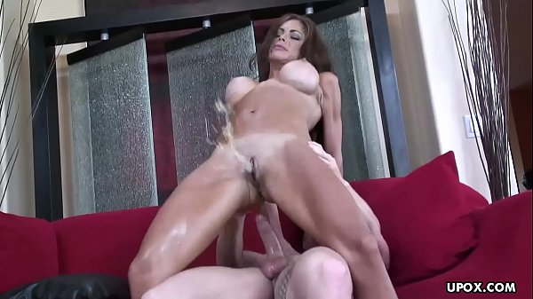 Voluptuous fake tits brunette receives a rough doggy style pounding Thumb
