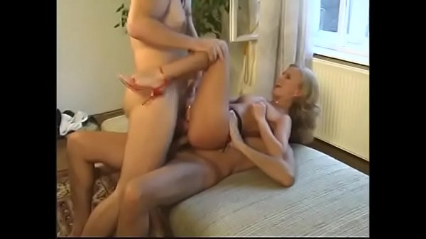 Pretty blonde with juicy ass gets double penetration on the big bed